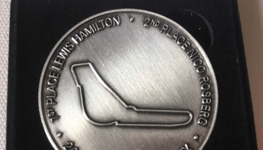 Mercedes F1 2014 F1 medals awarded to the members of the Mercedes F1 team to commemorate there 2014 championship win