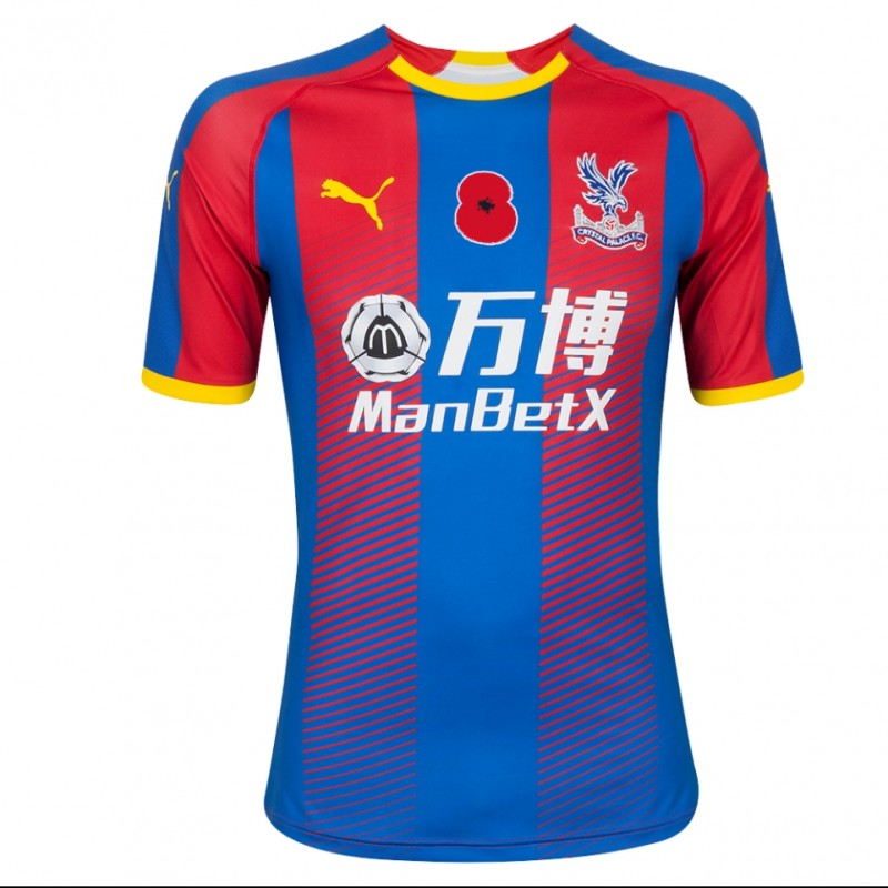 Wilfried Zaha's Crystal Palace F.C. Match-Issue Signed Home Poppy Shirt