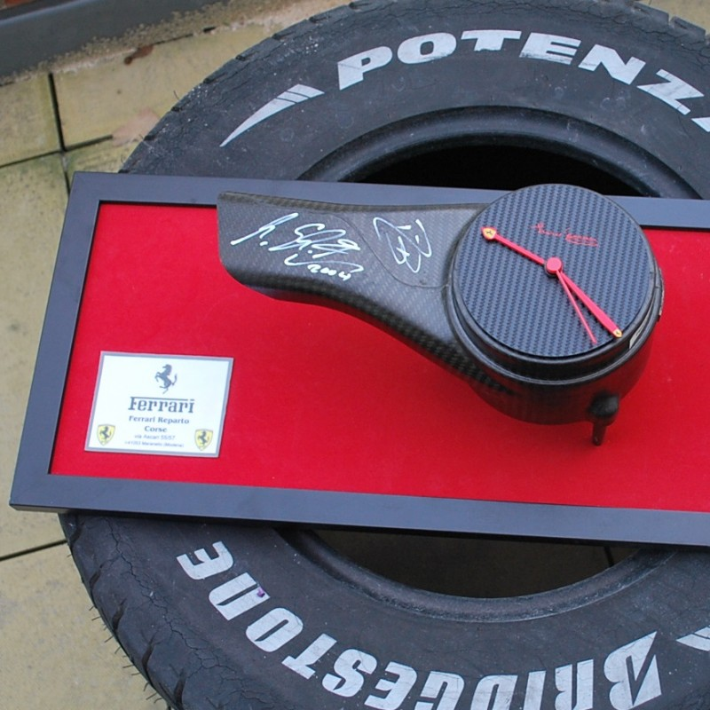 Michael Schumacher F2004 brake duct clock signed by the 7 Times F1 World Champion and Barrichello