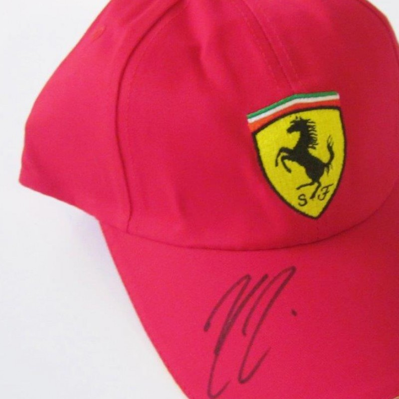 Ferrari cap signed by Alonso and Raikkonen
