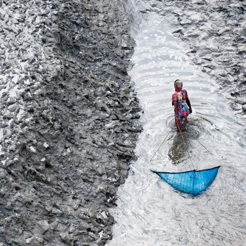 """""""Donna che pesca"""" Photograph by Yann Arthus-Bertrand"""
