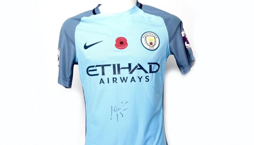 b09a5c606 Navas Worn and Signed Manchester City Poppy Shirt - CharityStars