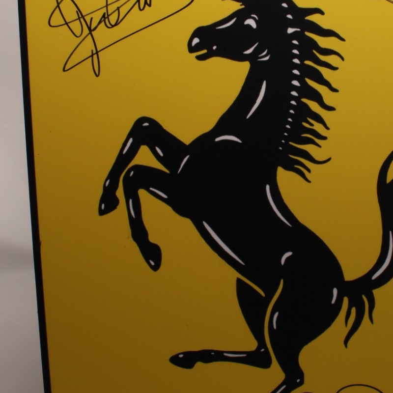 Ferrari Logo Signed by John Surtees, Jody Scheckter and Nigel Mansell