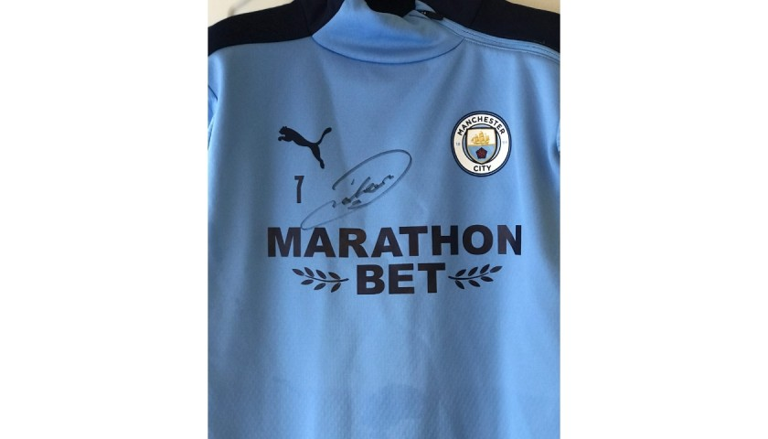 Sterling's Worn Manchester City Signed Training Top