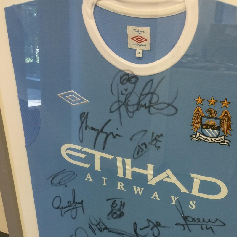 Framed Manchester City 09/10 Home Shirt Signed by the Squad
