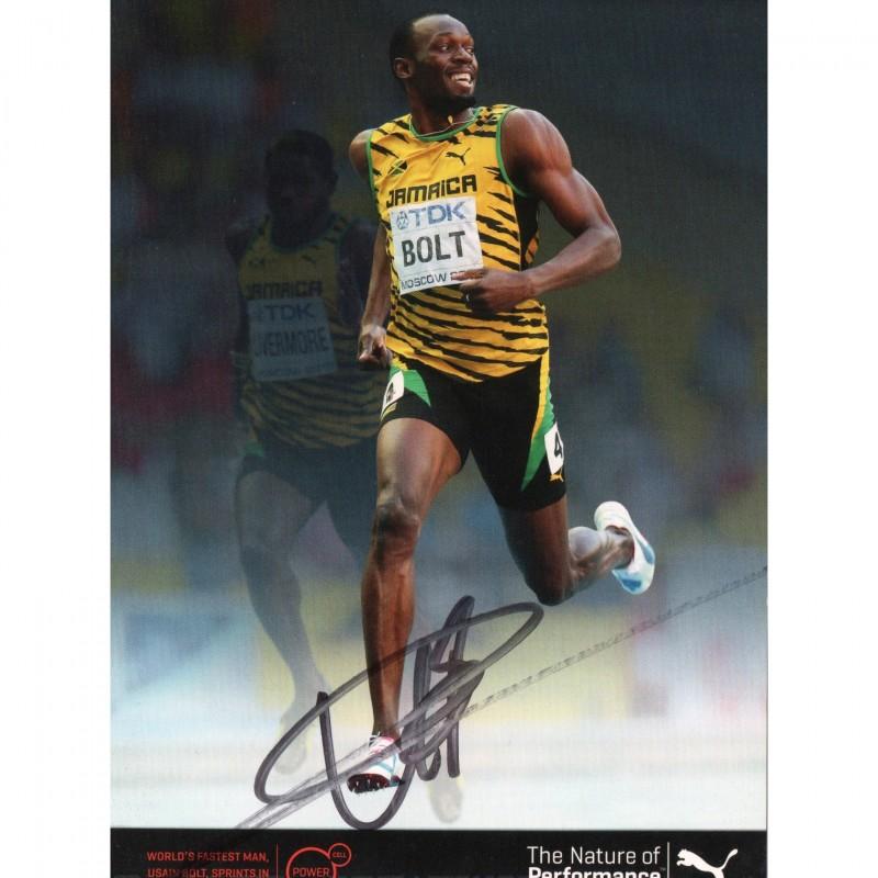 Fotografia cartonata autografata da Usain Bolt