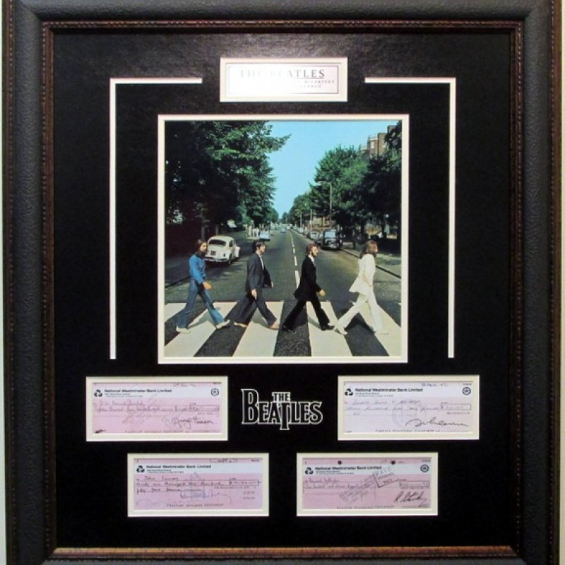 The Beatles Display with Replica Signed Checks from Each Member