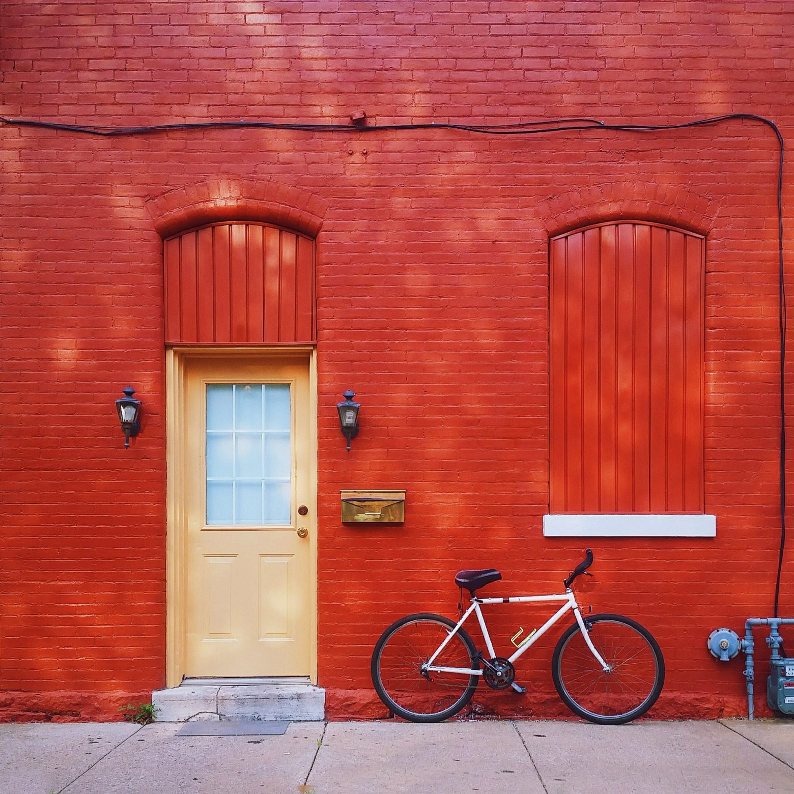 Bicycle in front of the red house
