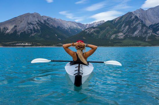 Girl relaxes on her kayak