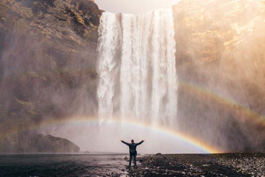 Man feeling the water falls