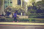 A girl jogging in the street