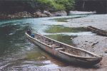 Small Wood Motor Boat On River