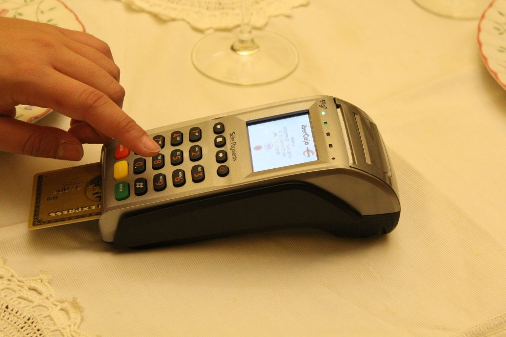 This is not the reader we use. Why is there a credit card reader on a formally set dining table?