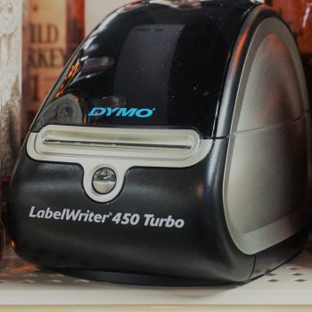 Dymo LabelWriter Over shelf with it's own label underneath
