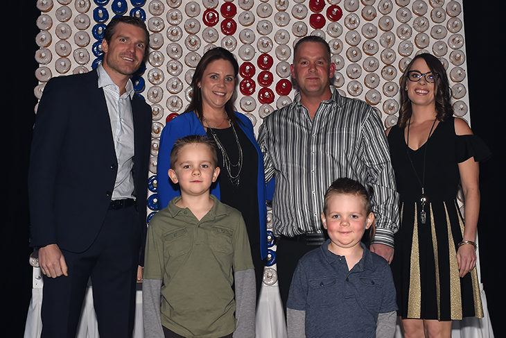 David Clarkson (left) and Michelle Fortin (right) join the Holm Family at DREAM. Gage Holm (lower right) is one of Clarky's Kids who receives cancer treatment at the POGO Satellite Centre at Grand River Hospital.