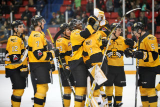 The Brandon Wheat Kings celebrate a win against the Lethbridge Hurricanes earlier this year.