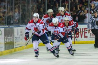 The Lethbridge Hurricanes celebrate a goal against the Red Deer Rebels.