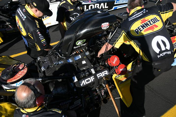 Leah Pritchett s team prepares her Mopar-powered Top Fuel dragster during  qualifying for the 17th annual NHRA Nationals at The Strip at … af4887466cbf8