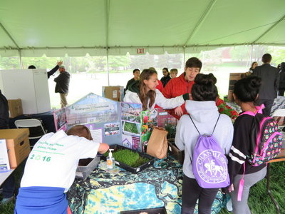 Environmental communication students share information with children attend the showcase