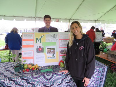Environmental communication students show off their materials for the SEAS