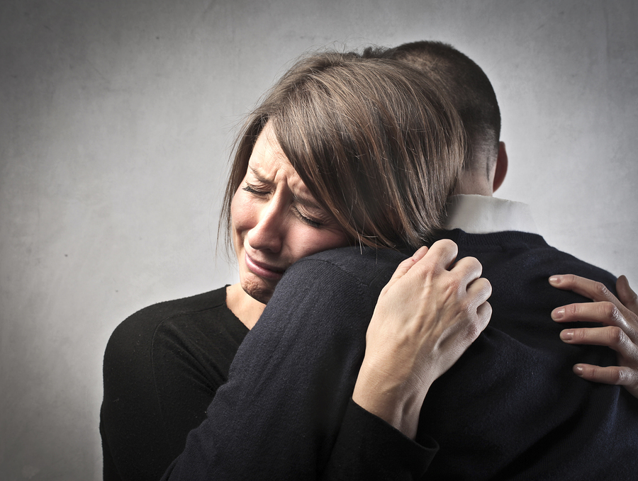 bigstock-Sad-woman-hugging-her-husband-30688547