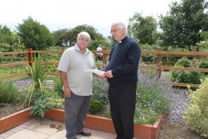 St Peter's community garden, Ian Thompson and Revd Colin Sutton