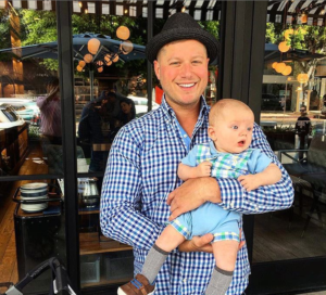 A Circle Surrogacy dad enjoys a day out with his baby.
