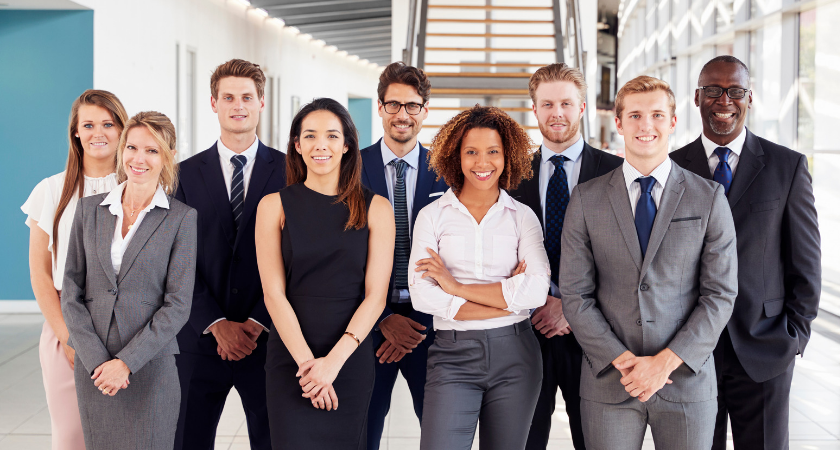 Office workers in a modern lobby, group portrait.png