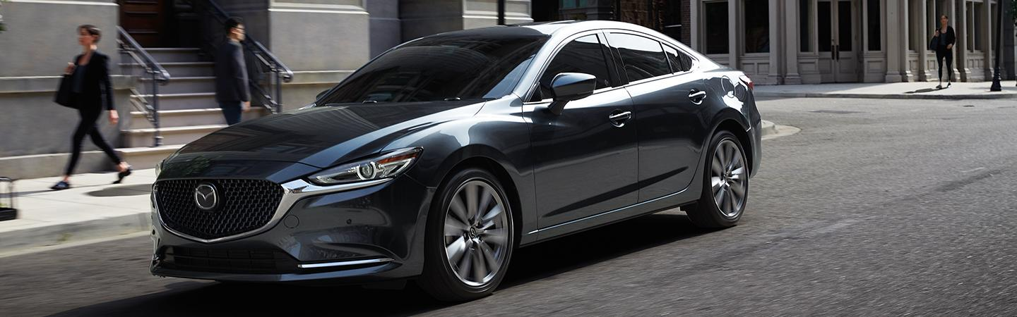 Side view of the 2020 Mazda6 parked on the curb