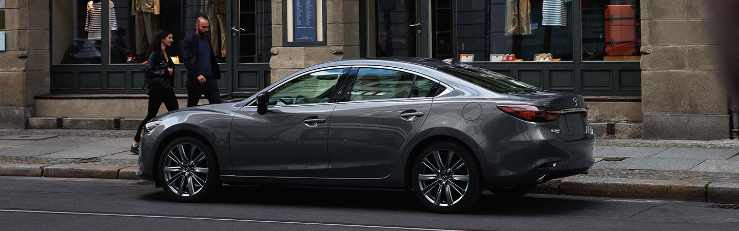 Side view of the 2020 Mazda6 parked outside on the curb