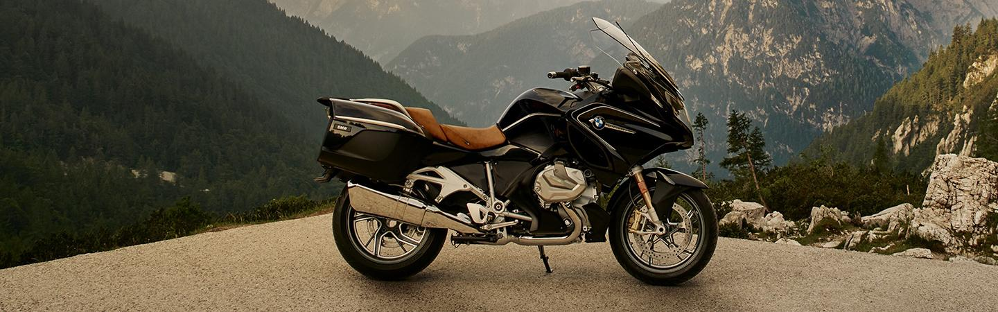 Side view of the 2020 BMW R 1250 RT parked on top of a mountain