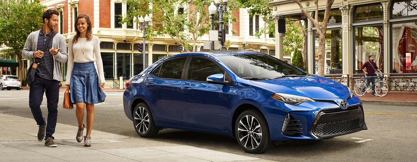 Blue 2020 Toyota Corolla parked on a city street