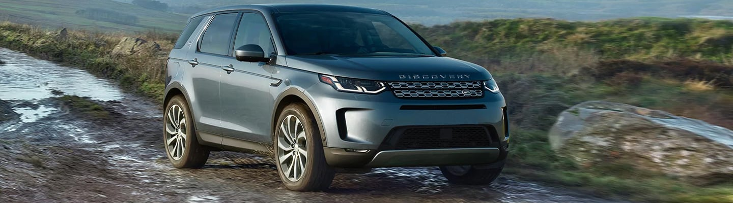 Front view of the 2020 Land Rover Discovery driving off road near Ocala, FL