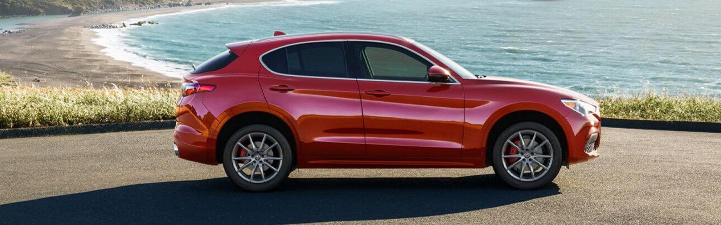 Passenger's side profile of red Stelvio