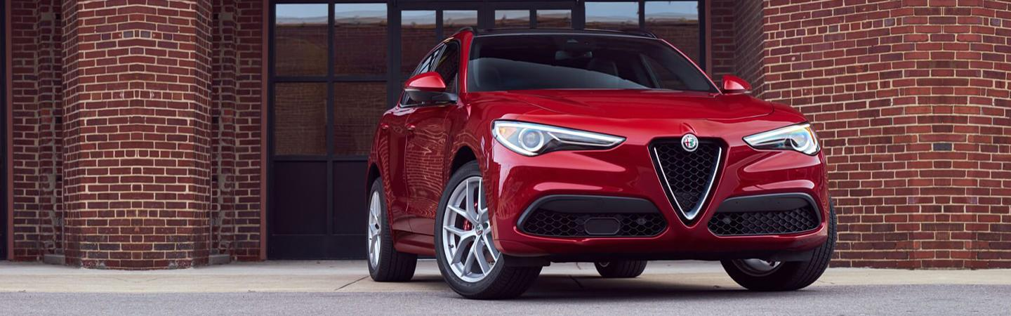 Front view of red Stelvio parked