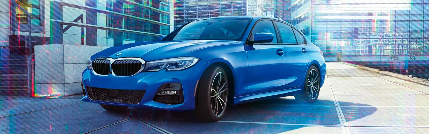 Blue 2020 BMW 3 Series parked outside of a building
