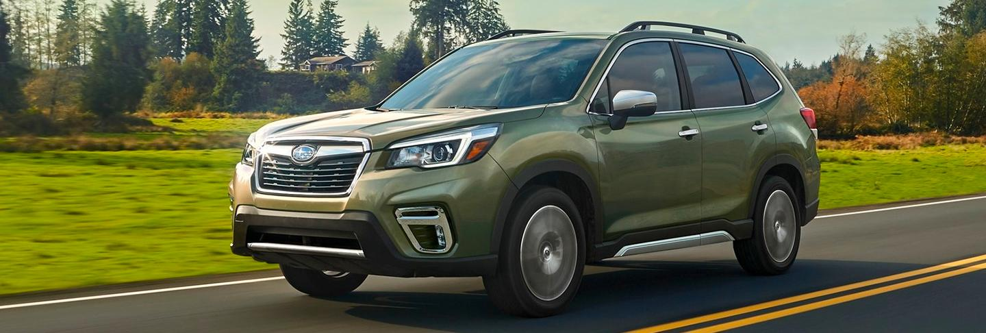 Green 2020 Subaru Forester on road