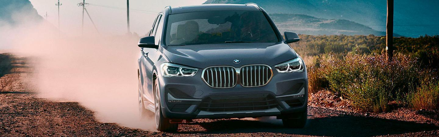 2020 BMW X1 driving on a dirt road