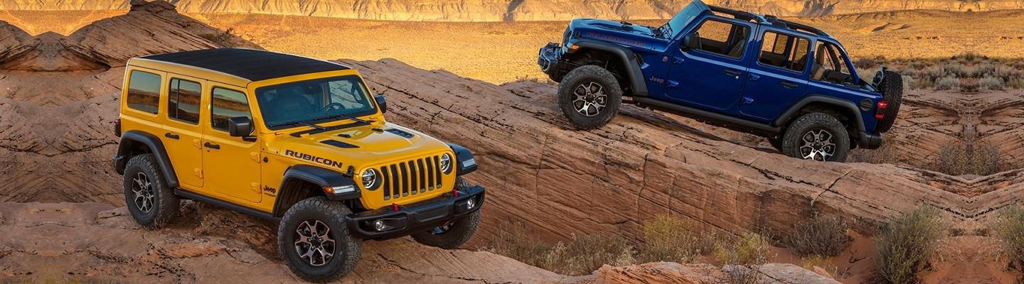 Two 2020 Jeep Wrangler models parked in canyon
