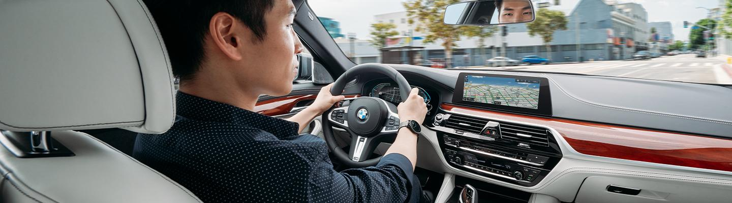 Driver using technology in the 2020 BMW 5 Series