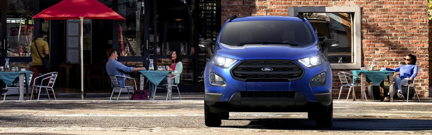 Front view of the 2020 Ford EcoSport parked in front of a café