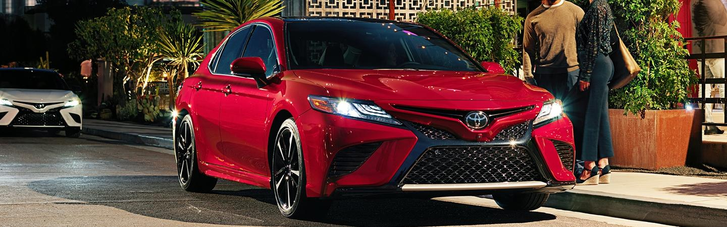 Red 2020 Toyota Camry parked on a city street