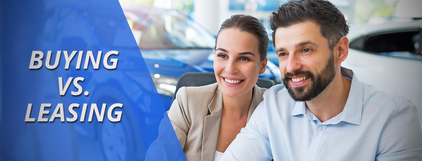 Two individuals in a car dealership