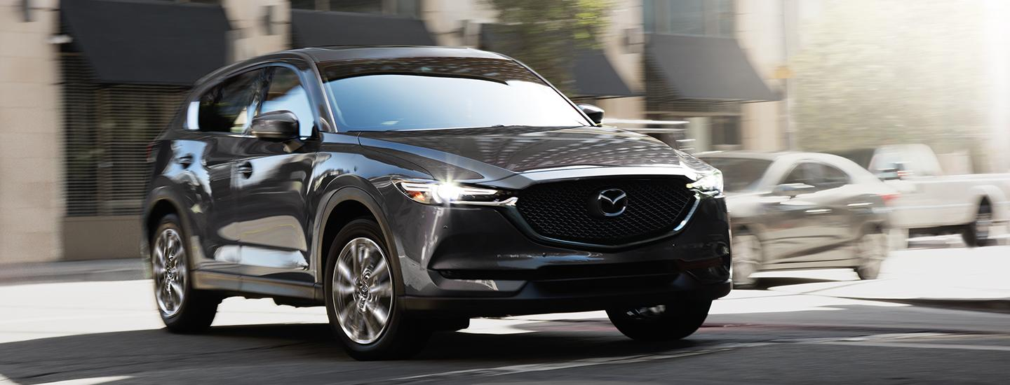 Front view of a grey 2020 Mazda CX-5 in motion