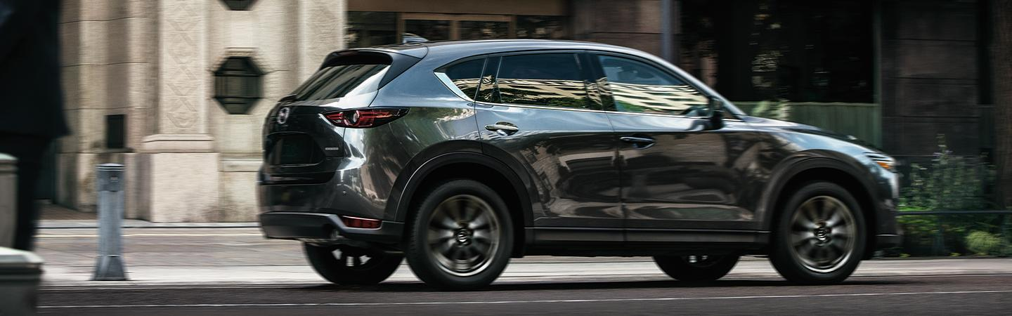 left side view of a grey 2020 Mazda CX-5 in motion