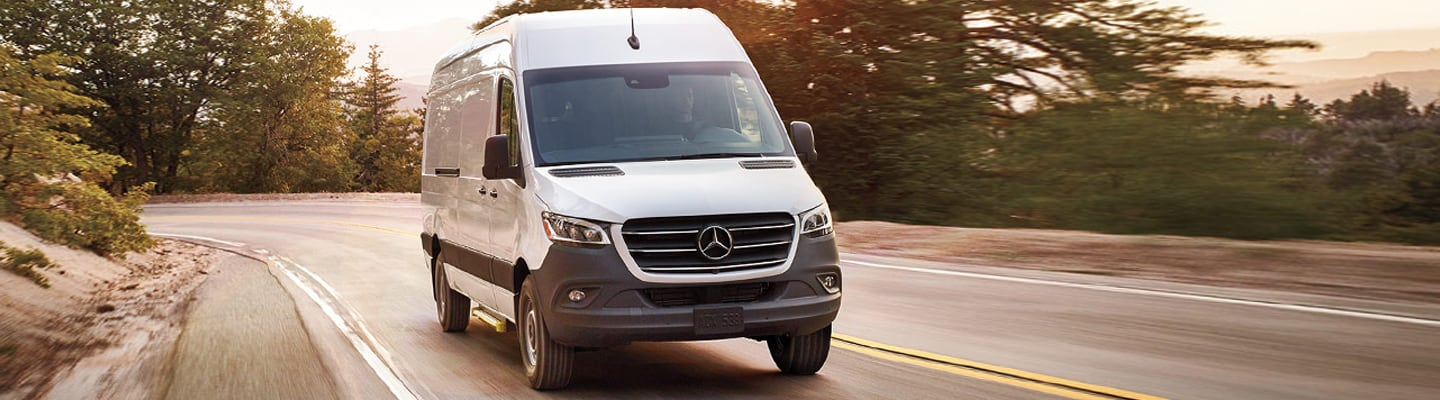 Front view of a 2020 Mercedes-Benz Sprinter in motion
