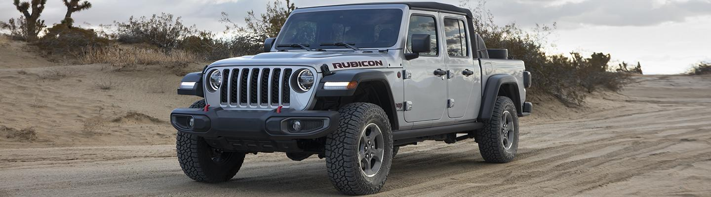 2020 Jeep Gladiator on dirt road in motion