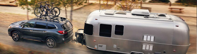 Blue 2021 Subaru Ascent Touring towing RV