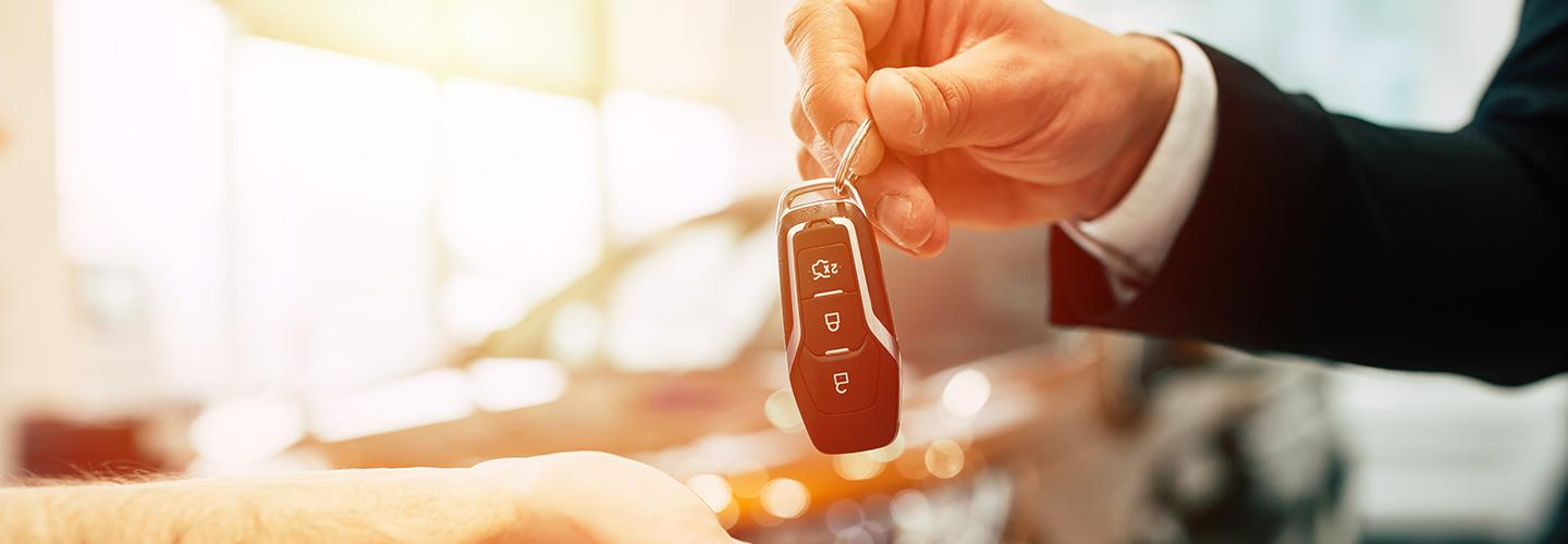 handing over keys to a car