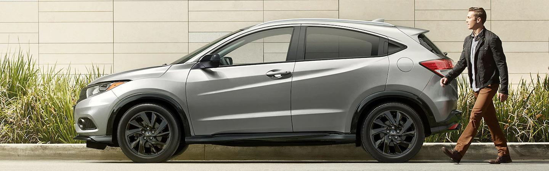 Side profile of a parked silver Honda HR-V